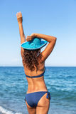 Woman enjoying warm summer day at a seaside. stock photography