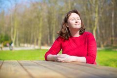 Woman enjoying warm weather in park royalty free stock image