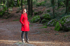 Woman enjoying the warmth of the winter sunlight on a forest Royalty Free Stock Photography