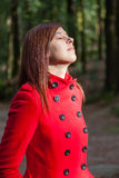 Woman enjoying the warmth of the winter sunlight on a forest Royalty Free Stock Images