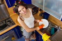Woman enjoying washing dishes Stock Image