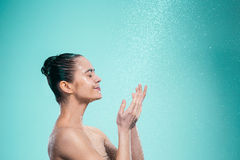 Woman enjoying water in the shower under a jet Royalty Free Stock Image