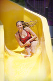 Woman Enjoying a Water Slide Stock Photography