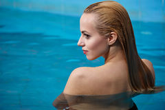Woman enjoying water in the swimming pool at the h Royalty Free Stock Image