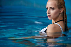 Woman enjoying water in the swimming pool at the h Stock Photography
