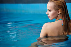 Woman enjoying water in the swimming pool Royalty Free Stock Photography
