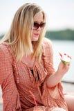 Woman enjoying watermelon Stock Photography