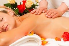 Woman enjoying wellness back massage Stock Image