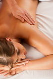 Woman enjoying wellness back massage Stock Image