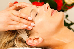 Woman enjoying wellness head massage Royalty Free Stock Photo