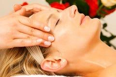 Woman enjoying wellness head massage royalty free stock photo