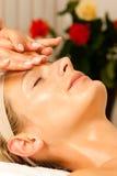 Woman enjoying wellness head massage Stock Image