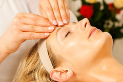 Woman enjoying wellness head massage Stock Images