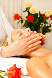 Woman enjoying wellness head massage Stock Photo