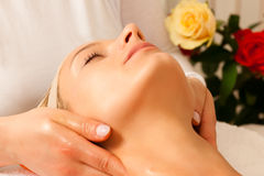 Woman enjoying wellness head massage Royalty Free Stock Images