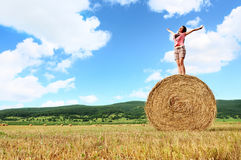 Woman enjoying on the wheat Stock Photography