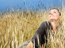 Woman enjoying on the wheat field Stock Image