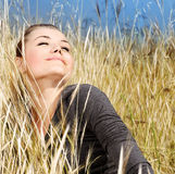 Woman enjoying on the wheat field Stock Photos