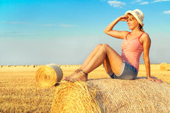 Woman enjoying on the wheat field Royalty Free Stock Images