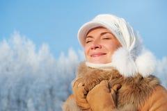 Woman enjoying winter day Royalty Free Stock Photos