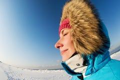 Woman enjoying winter day royalty free stock photography