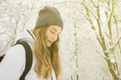 Woman enjoying winter mountains wearing cozy sweater and hat Travel Lifestyle adventure concept vacations into the wild Stock Images