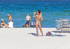 Woman enjoys the  beautiful beach Royalty Free Stock Photography