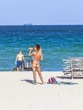 Woman enjoys the  beautiful beach in Miami Royalty Free Stock Photos