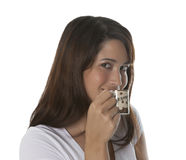 Woman enjoys a cup of espresso. In front of a white background Stock Photos