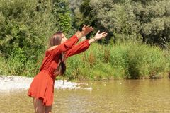 Woman enjoys her free time at the Isar river in Munich Stock Photos