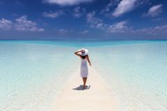 Woman enjoys her tropical vacation on a paradise beach royalty free stock images