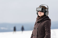 Woman enjoys her vr glasses Stock Photography