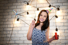 Woman enjoys the holiday on the brick wall background. Stock Photos