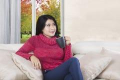 Woman enjoys hot coffee Royalty Free Stock Photos