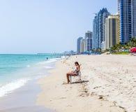 Woman enjoys Jade beach Stock Photo