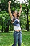 Woman enjoys life outdoors Stock Photography