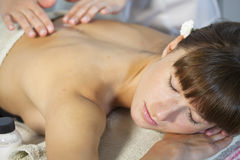 Woman enjoys massage Stock Photography