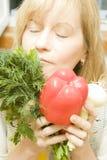 Woman enjoys organic food Stock Images