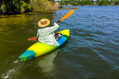 Woman Enjoys Quality Time in Her Kayak royalty free stock image