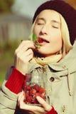Woman enjoys raspberry Stock Photos