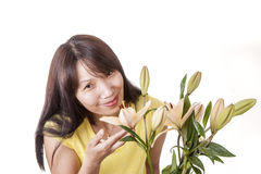 Woman enjoys the smell of lilies. Royalty Free Stock Images