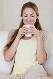 Woman enjoys smelling on her fresh made coffee Royalty Free Stock Photos