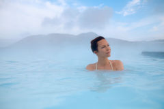 Woman enjoys spa in geothermal hot spring.  Royalty Free Stock Photo