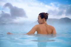 Woman enjoys spa in geothermal hot spring Stock Photos