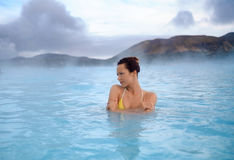 Woman enjoys spa in geothermal hot spring.  Royalty Free Stock Photography