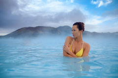 Woman enjoys spa in geothermal hot spring.  Stock Photography