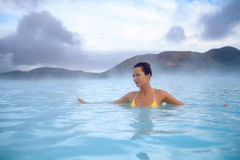 Woman enjoys spa in geothermal hot spring.  Stock Images