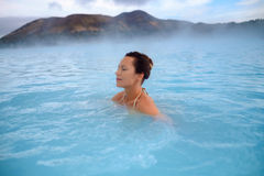 Woman enjoys spa in geothermal hot spring Royalty Free Stock Photo