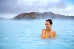 Woman enjoys spa in geothermal hot spring Royalty Free Stock Images