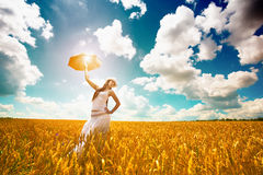 Woman is enjoys summer day in the field Royalty Free Stock Image